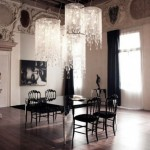 dining room elegant with contemporary crystal chandeliers deliver a dazzling, heavy opulence to the dining rooms