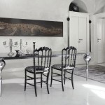 dining room with elegant chairs and paintings crocodile give the impression of luxury