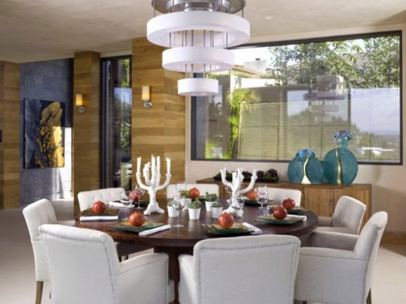 dining room with white padded chairs