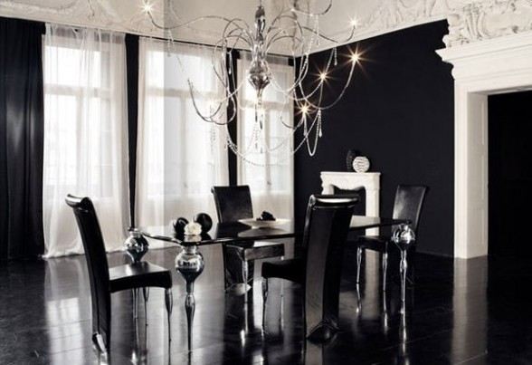 luxury dining room with black shades combined with a unique light