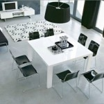 the dining room for eight people with table white, black chairs looks formal