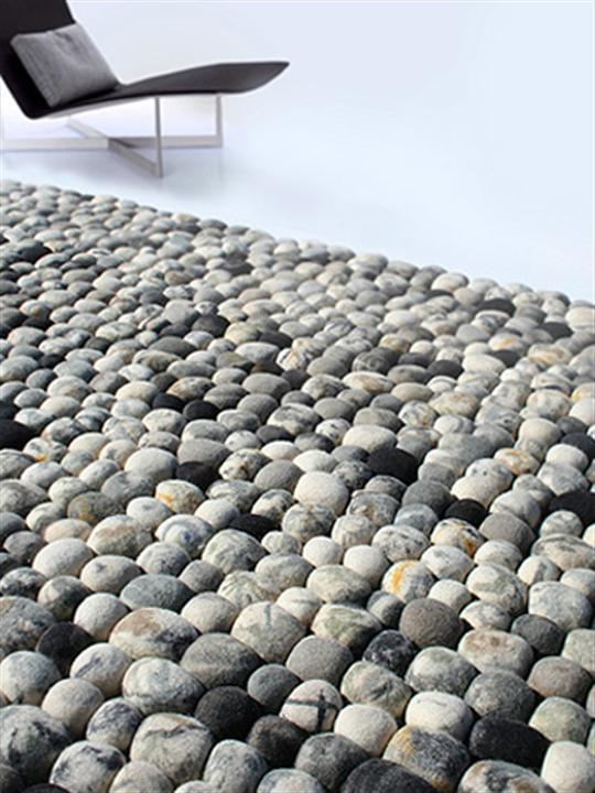 A Pebble Rug Beside A Lounge