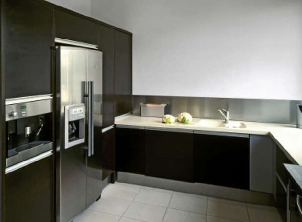 Compact black and white kitchen