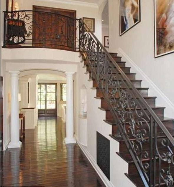 Grand entrance-The large hallway features an intricate wrought iron staircase leading upstairs-Kim Kardashian's