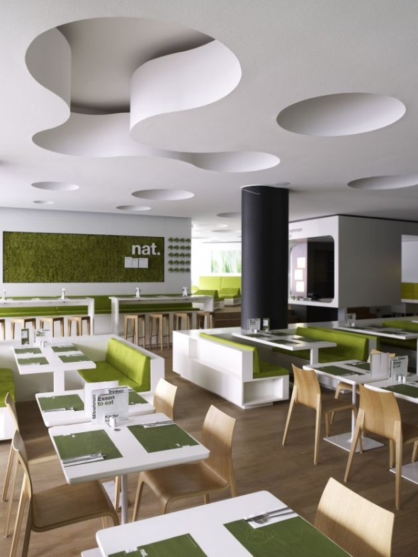 The lounge area consists of individual green islands, allowing for varied seating configurations