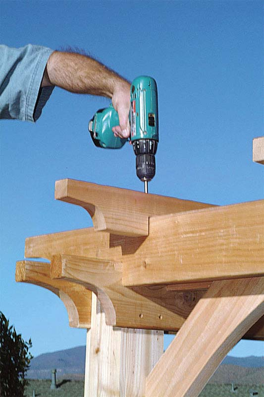 bore pilot holes and attach the slats with 3-in. No. 10 screws (13)-building pergolas