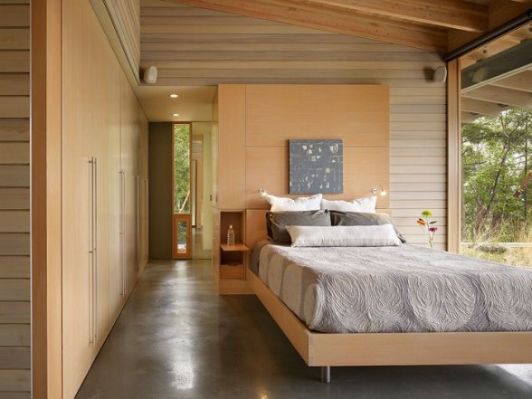 interior design a comfortable bedroom with walls and wood furniture looks warm and with large glass window transparent