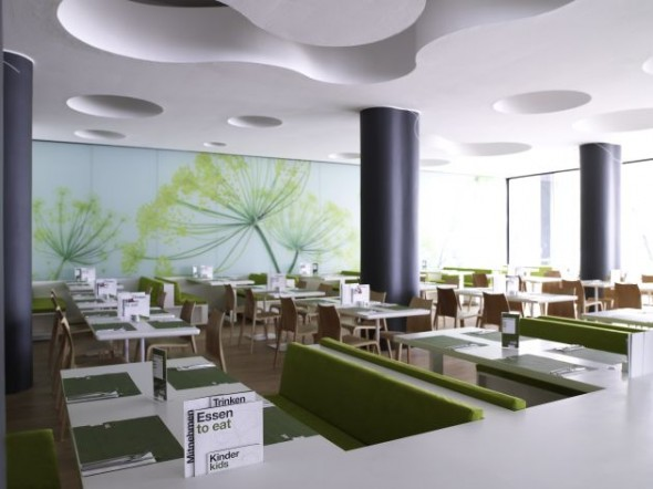 interior restaurant with motifs from nature with the color green with wallpapers water plants