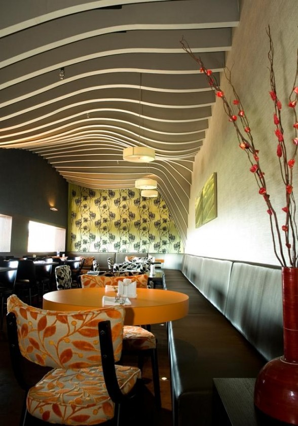 plant motives decorating chairs and the wide windows-Rosso Restaurant Interior by SO Architecture