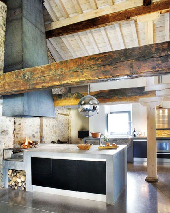 rusting kitchen interior design with wood beams and fireplace with a cozy village atmosphere