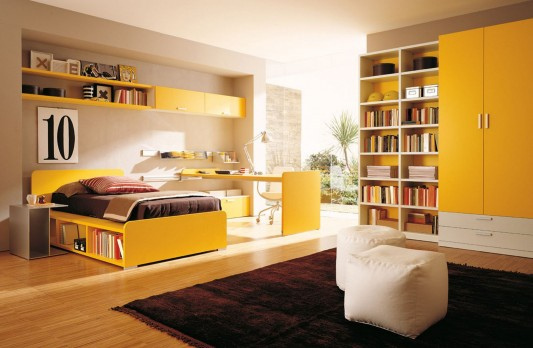 yellow color teen bedroom with modern combinatio n bookshelves and wardrobes