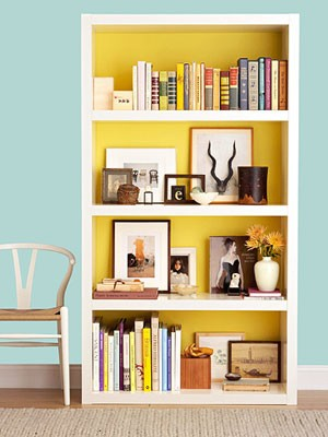 yellow on the inside-shelf with a reading nook
