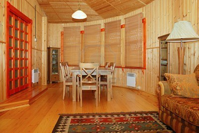 Old Country Style Dining Room interior-The floor to ceiling wood paneling lends this room a rustic country air