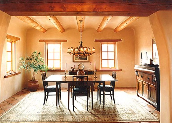 Southwest Style Decorating-A classic Dining Room with a plaster cove ceiling, Saltillo Tile floors, and plastered walls