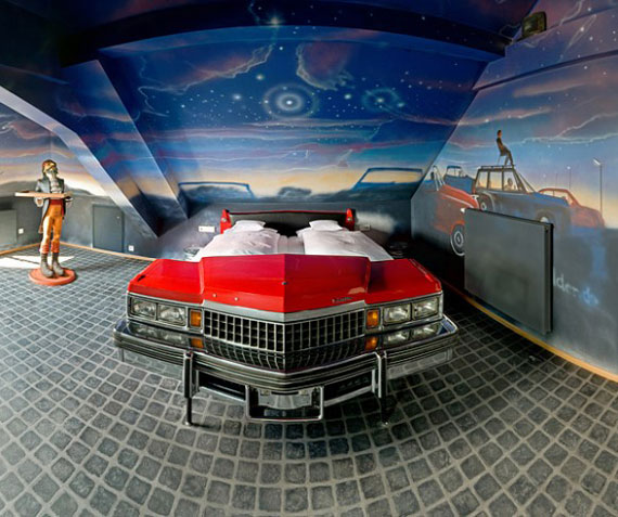 Red bed of car with skyline theme