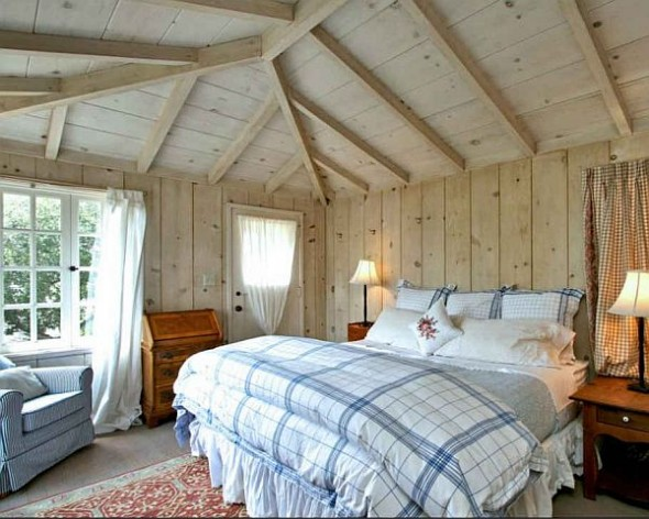 cottage bedroom with paneled walls and ceilings