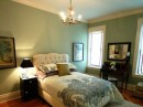 Traditional bedroom featuring green as the main color