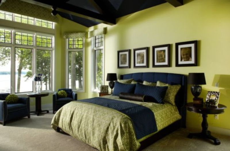 Traditional guest bedroom featuring soft green walls