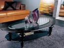 Coffee Table - Oval Glass Top Framed within Ornate Black Top